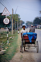 Nepalganj, 24 February 2005.  A rickshaw driver is waiting for customers