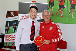 NEWPORT, WALES - Sunday, May 28, 2017: Iwan Roberts receives a cap from Elite Performance Director Ian Rush for participation during day three of the Football Association of Wales' National Coaches Conference 2017 at Dragon Park. (Pic by Mark Roberts/Propaganda)