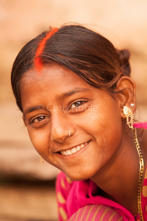 A portrait of a young woman at the Mani Karnika (Main) Ghat on the banks of the Ganges River in Varanasi India.