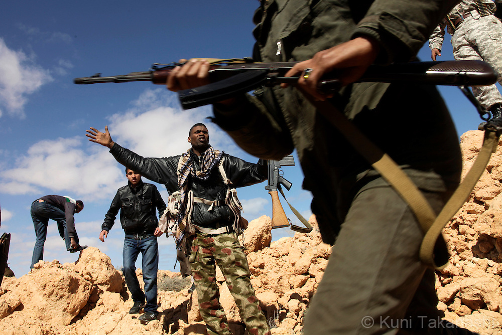 Rebel militia agasint Col. Muammar Gaddafi near Ben Jawat on March 6, 2011 as they fight against Gaddafi's army. The government troop re-took control of the town Sunday. .Photo by Kuni Takahashi