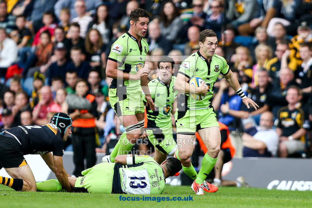 George North of Northampton Saints (right) attacks during the Aviva Premiership match at Adams Park, High Wycombe<br /> Picture by Andy Kearns/Focus Images Ltd 0781 864 4264<br /> 14/09/2014