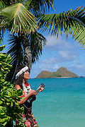Woman playing ukulele,Mokulua Islands, Lanikai, Kailua, Oahu, Hawaii