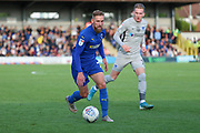 AFC Wimbledon midfielder Scott Wagstaff (7) dribbling during the EFL Sky Bet League 1 match between AFC Wimbledon and Portsmouth at the Cherry Red Records Stadium, Kingston, England on 19 October 2019.