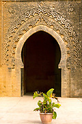 RABAT, MOROCCO - 17th October 2015 - Archway entrance to Chellah Gardens with decorative plant pot, Rabat, Morocco.