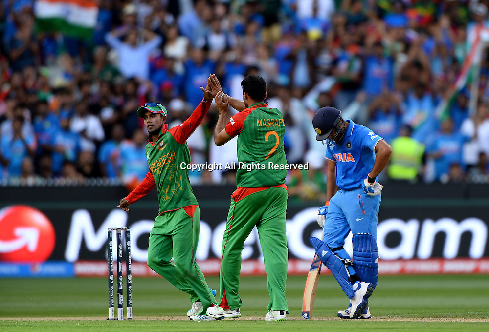 Masrafe Bin Mortaza (Bang) gets the wicket of S Raina (IND)<br /> India vs Bangladesh / Qtr Final 2<br /> 2015 ICC Cricket World Cup<br /> MCG / Melbourne Cricket Ground <br /> Melbourne Victoria Australia<br /> Thursday 19 March 2015<br /> &copy; Sport the library / Jeff Crow