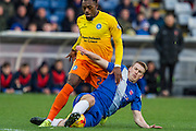 Hartlepool United defender Adam Jacksontackles Gozie Ugwu (Forward) of Wycombe Wanderers on the edgeof the box during the Sky Bet League 2 match between Hartlepool United and Wycombe Wanderers at Victoria Park, Hartlepool, England on 16 January 2016. Photo by George Ledger.