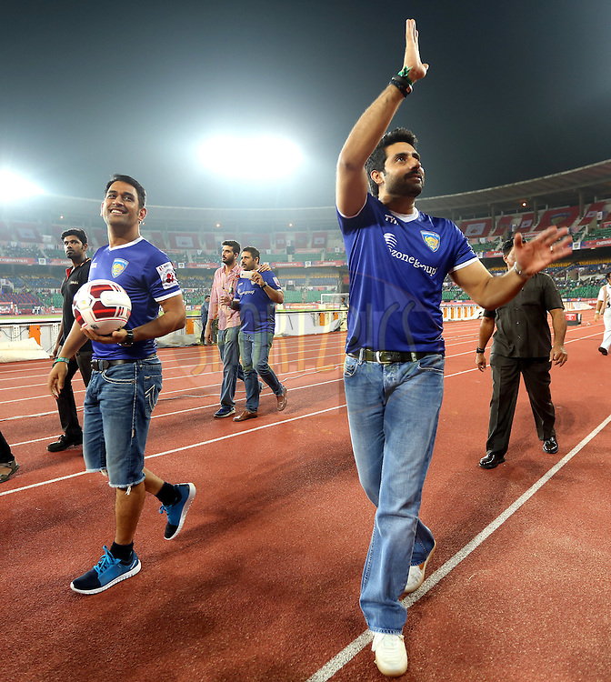 MS Dhoni co owner of Chennaiyin and Actor Abhishek Bachchan owner of Chenaiyin FC during match 15 of the Hero Indian Super League between Chennaiyin FC and Mumbai City FC held at the Jawaharlal Nehru Stadium, Chennai, India on the 28th October 2014.<br /> <br /> Photo by:  Sandeep Shetty/ ISL/ SPORTZPICS
