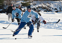 Jeff Kruger of the over 40 Bumbles team takes to the ice with the Milton Mapleleafs in sudden death overtime during the New England Pond Hockey Classic Sunday afternoon.  (Karen Bobotas/for the Laconia Daily Sun)