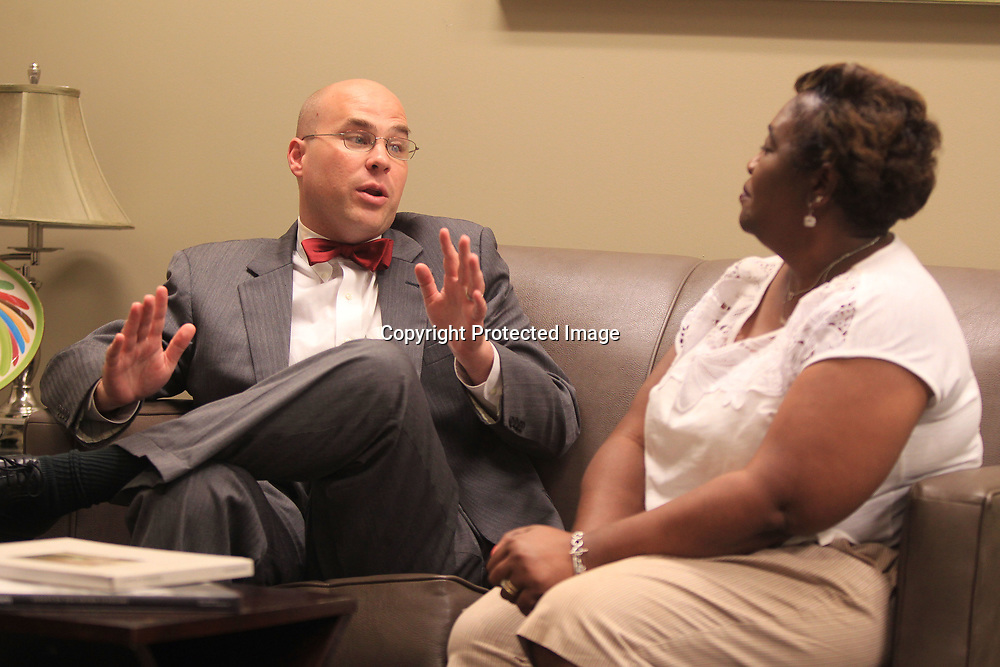 Outgoing Starkville Mayor Parker Wiseman, talks with his secretary Vickie Hampton in Starkville City HAll on Thursday.