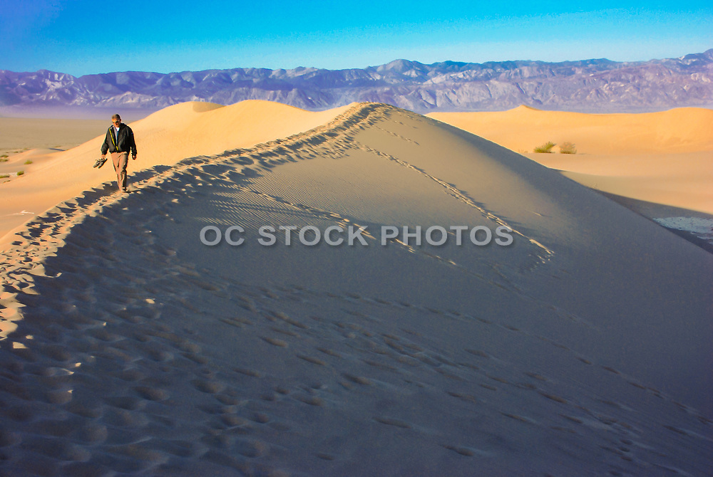 Tourist Walking Through the Eureka Valley Sand Dunes