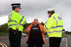 © licensed to London News Pictures. Ellesmere Port, UK 08/05/2011. Fuel protest organiser, Ian Charlesworth, talks to police outside Stanlow Oil Refinery. Fuel protesters are due to blockade the Stanlow Oil Refinery at Ellesmere Port, Cheshire. Organiser, Ian Charlesworth says that a 24 pence discount off the price of a litre of petrol is required to bring the UK in line with average European pricing and to keep British businesses competitive. He says he is expecting more than 1000 vehicles to turn up and is expecting to stay for at least a week. Please see special instructions for usage rates. Photo credit should read Joel Goodman/LNP