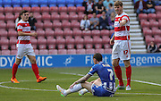 McCann goes down during the Sky Bet League 1 match between Wigan Athletic and Doncaster Rovers at the DW Stadium, Wigan, England on 16 August 2015. Photo by Simon Davies.