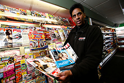 UK ENGLAND BERKSHIRE UPPER BUCKLEBURY 22MAR11 - Hash Shingadia (52) displays Kate Middleton's favourite magazines at his Spar store in Upper Bucklebury, Berkshire, England. He took over the village's Peaches Store 13 years ago and is the proud recipient of an invite to the Royal Wedding of Kate Middleton and Prince William...jre/Photo by Jiri Rezac..© Jiri Rezac 2011
