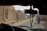 Timbuktu, Mali, 2009 –  Prayer beads hang from the rearview mirror of a Land Cruiser driving through central Timbuktu.