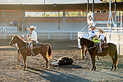 Members of the Franco Family of famous charros during Team Roping of a steer at the family Charreria practice session in the Jalisco Highlands town of Capilla de Guadalupe, Mexico.