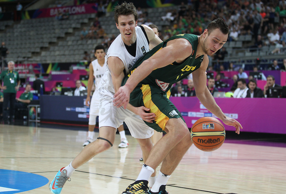 New Zealand's Thomas Abercrombie and Lithuania's Donatas Motiejunas compete for the ball in the round of 16 at the FIBA Basketball World Cup, Palau Sant Jordi Arena, Barcelona, Spain, Sunday, September 7, 2014. Credit:SNPA / Ben Campbell