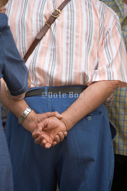 elderly couple seen from behind