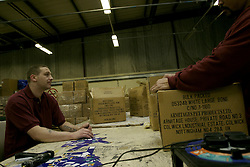 UK ENGLAND NOTTINGHAM 14DEC04 - Unidentified inmates unpack a box of dog treats in a workshop at HMP Lowdham Grange in Nottinghamshire. This newly-built prison is entirely run and controlled by private company Premier-Serco on contract from the Home Office since 1998. The facility holds over 500 Category-B and C inmates with an minimum sentence of 4 years.<br /> <br /> jre/Photo by Jiri Rezac<br /> <br /> © Jiri Rezac 2004<br /> <br /> Contact: +44 (0) 7050 110 417<br /> Mobile:  +44 (0) 7801 337 683<br /> Office:  +44 (0) 20 8968 9635<br /> <br /> Email:   jiri@jirirezac.com<br /> Web:     www.jirirezac.com<br /> <br /> © All images Jiri Rezac 2004 - All rights reserved.
