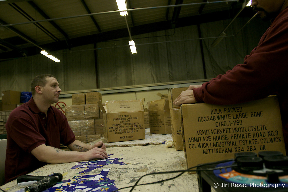 UK ENGLAND NOTTINGHAM 14DEC04 - Unidentified inmates unpack a box of dog treats in a workshop at HMP Lowdham Grange in Nottinghamshire. This newly-built prison is entirely run and controlled by private company Premier-Serco on contract from the Home Office since 1998. The facility holds over 500 Category-B and C inmates with an minimum sentence of 4 years.<br /> <br /> jre/Photo by Jiri Rezac<br /> <br /> &copy; Jiri Rezac 2004<br /> <br /> Contact: +44 (0) 7050 110 417<br /> Mobile:  +44 (0) 7801 337 683<br /> Office:  +44 (0) 20 8968 9635<br /> <br /> Email:   jiri@jirirezac.com<br /> Web:     www.jirirezac.com<br /> <br /> &copy; All images Jiri Rezac 2004 - All rights reserved.