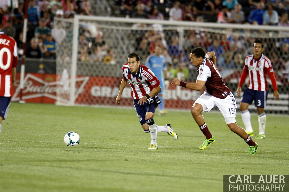 May 25th, 2013 Commerce City, CO - Chivas USA midfielder Eric Avila (15) attempts to get past the defense by Colorado Rapids defender Chris Klute (15) in the second half of the MLS match between Chivas USA and the Colorado Rapids at Dick's Sporting Goods Park in Commerce City, CO