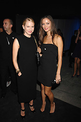 Left to right, NAOMI WATTS and GEORGINA CHAPMAN at an exclusive installation by Martin Creed and presentation of the Calvin Klein Spring 2008 collection held at P3 35 Marylebone Road, London on 15th October 2007.<br />