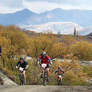 Cyclist David Grey (left) and Paula Cross (192) in action during the New World Tour de Wakatipu bike race on Saturday. Six hundred and ninety people entered the bike race which featured an  exclusive course with breathtaking views from Millbrook Resort in Arrowtown to Chard Farm along the Kawarau River, via the trails and tracks of the Wakatipu basin with distances of 36 kilometres fun riding for recreational bikers and 45 kilometres for elite and sport racers. The event was part of the inaugural Queenstown Bike Festival, which took place from 16th-25th April. The event hopes to highlight Queenstown's growing profile as one of the three leading biking centres in the world. Queenstown, Central Otago, New Zealand. 23rd April 2011. Photo Tim Clayton..