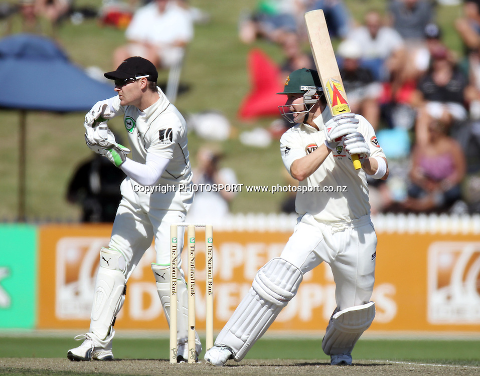 Australia's Michael Clarke batting as Brendon McCullum looks on.<br />