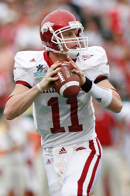 University of Arkansas quarterback Casey Dick drops back to pass during the Wisconsin Badgers 17-14 victory over the Arkansas Razorbacks in the Capital One Bowl at the Florida Citrus Bowl Stadium in Orlando, Florida on January 1, 2007.