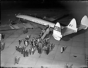 28/04/1958<br /> 04/28/1958<br /> 28 April 1958<br /> Inaugural Aerlinte flight to the United States from Dublin Airport. Picture shows passengers boarding the Seaboard Super Constellation plane at Dublin Airport.