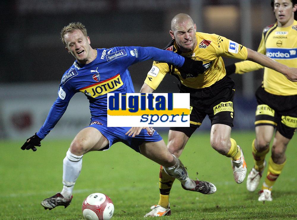 Fotball<br /> Tippeliga 2006<br /> 15.10.2006<br /> Sandefjord v Lillestr&oslash;m<br /> Foto: Morten Olsen, Digitalsport<br /> <br /> Kasey Wehrman - LSK<br /> Tommy Knarvik - Sandefjord