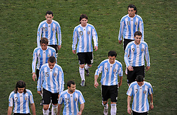Dejected Argentina players Martin DEMICHELIS (NR. 2) , Javier MASCHERANO (Nr. 14), Angel DI MARIA (Nr. 7), Nicolas OTAMENDI (Nr. 15), Nicolas BURDISSO (Nr. 4), Gabriel HEINZE (Nr. 6),  Gonzalo HIGUAIN (Nr. 9), Maxi RODRIGUEZ (Nr. 20), Lionel MESSI (Nr. 10) and Carlos TEVEZ (Nr. 11) leave the pitch after losing 4-0  in  the 2010 FIFA World Cup South Africa Quarter Final match between Germany and Argentina at the Green Point  Stadium on July 3, 2010 in Cape town, South Africa.