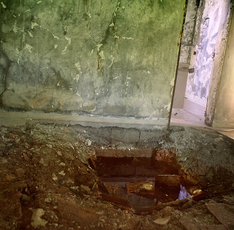 A hole left in the floor by treasure hunters in the house of the deceased drug lord Pablo Escobar in his former country residence, Hacienda Napoles.