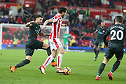 Kyle Walker and Joe Allen battle during the Premier League match between Stoke City and Manchester City at the Bet365 Stadium, Stoke-on-Trent, England on 12 March 2018. Picture by Graham Holt.