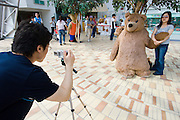 Jeju Island. Jungmun Tourist Complex. Teddybear Museum. Toursists taking souvenir photos with bears.