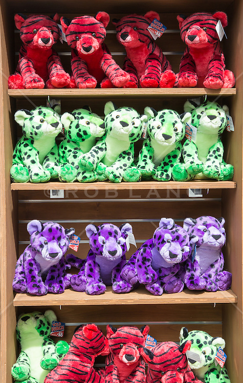 colorful stuffed animals on shelves