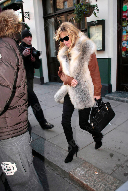 02.FEBRUARY.2012. LONDON<br /> <br /> KATE MOSS OUT IN PRIMROSE HILL AND CENTRAL LONDON<br /> <br /> BYLINE: EDBIMAGEARCHIVE.COM<br /> <br /> *THIS IMAGE IS STRICTLY FOR UK NEWSPAPERS AND MAGAZINES ONLY*<br /> *FOR WORLD WIDE SALES AND WEB USE PLEASE CONTACT EDBIMAGEARCHIVE - 0208 954 5968*
