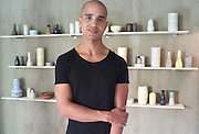 Picture shows portrait of ceremicist Eric Landon in his workshop in Kompagnistraede, Copenhagen, Denmark.<br /> 26/06/2013<br /> <br /> Credit should read: Picture by Mark Larner.<br /> <br /> Both a master potter and Designer, Eric is focused on a constant refinement of both form and technique. For him, the one cannot evolve naturally without the other. His love for wheel thrown pottery started already at age 16 and has evolved into a way of life, his vocation. For Eric, shaping objects by hand is not a look back at the past. He firmly believes that hand-crafting objects of a timeless value is a way forward.<br /> <br /> Eric is a graduate of the Danish school of Design in Copenhagen and has been awarded with a number of grants, international exhibition selections, and other distinguishments for the quality of his work.<br /> http://www.tortus-copenhagen.com