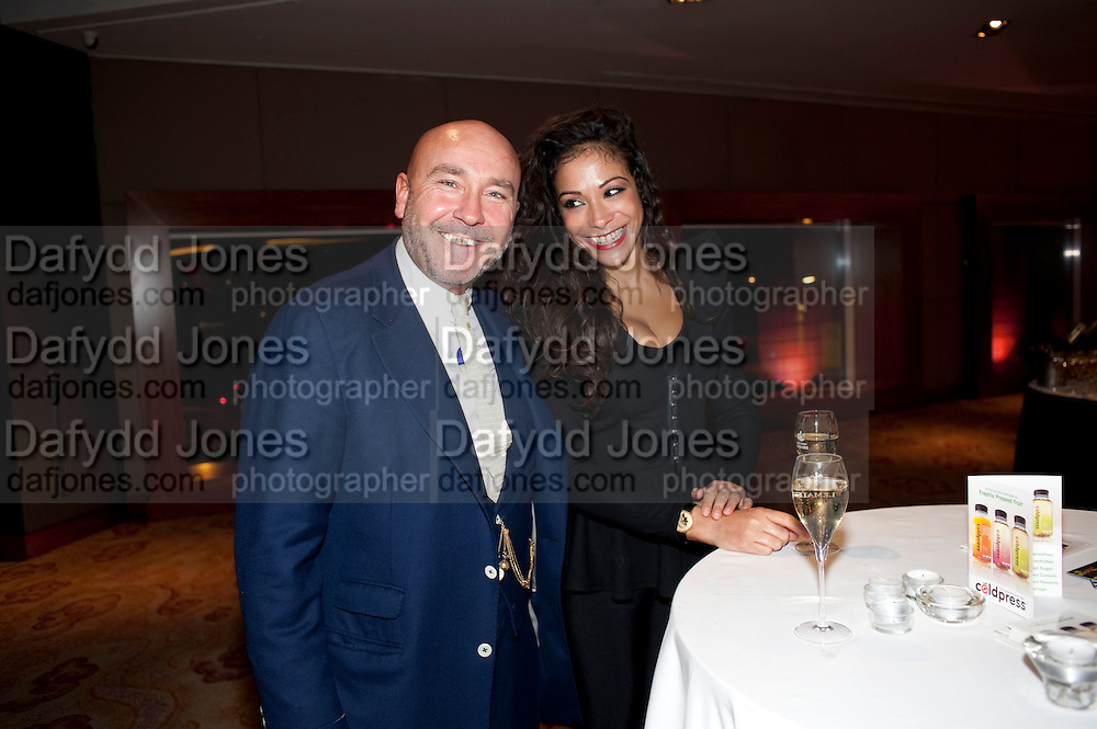 MARK POWELL; CHERISE COLLINGS, London Lifestyle Awards. Riverbank Park Plaza. London.6 October 2011. <br /> <br />  , -DO NOT ARCHIVE-© Copyright Photograph by Dafydd Jones. 248 Clapham Rd. London SW9 0PZ. Tel 0207 820 0771. www.dafjones.com.
