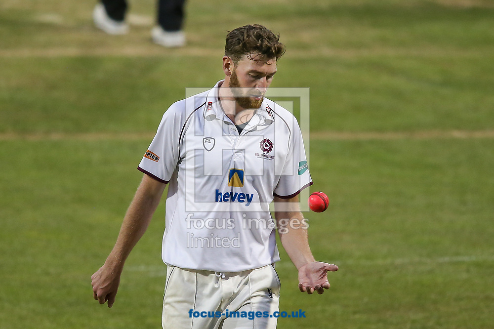 Richard Gleeson of Northamptonshire CCC juggles with the pink ball during the Specsavers County C'ship Div Two match at the County Ground, Northampton<br /> Picture by Andy Kearns/Focus Images Ltd 0781 864 4264<br /> 26/06/2017
