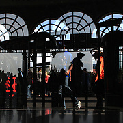 Fans leave the stadium through the arches at the entrance to Citi Field  after the New York Mets V San Francisco Giants Baseball game at Citi Field, Queens, New York. 21st April 2012. Photo Tim Clayton