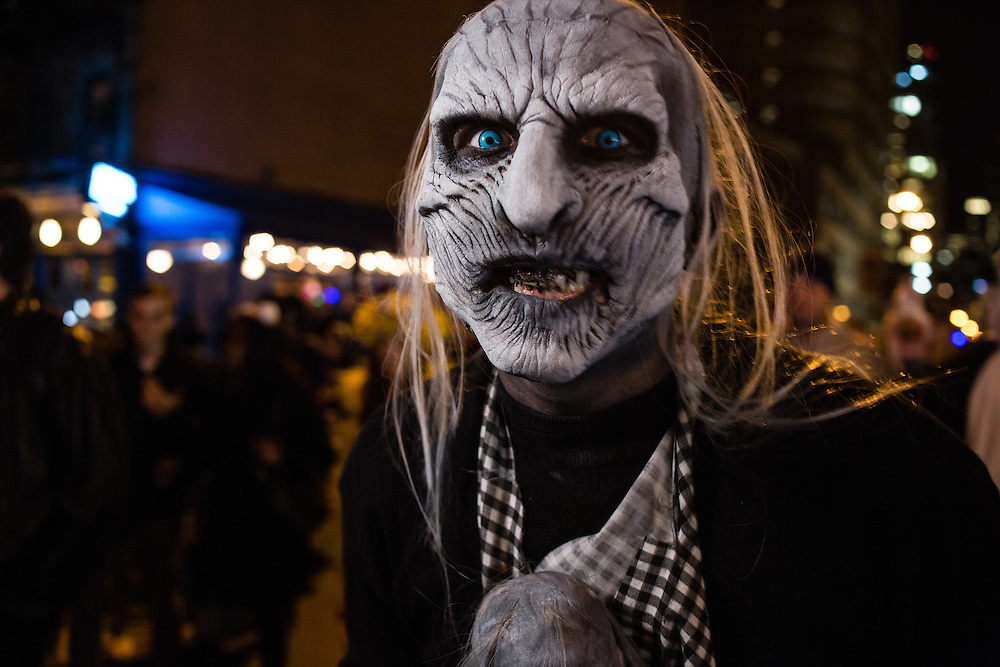New York, NY - 31 October 2016. A man in a scary white mask  in the Greenwich Village Halloween Parade.
