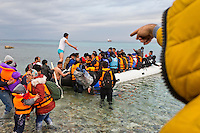 Turkey, Izmir, Cesme,<br /> <br /> January 2016 refugees from Afghanistan, Iran, Syria are ready for leaving Turkey to Greece hoping to reach the Greek Aegean islands Chios. Which is just a few nautical miles (6-8) away. The majority of the refugees came from war torn countries such as Syria and Afghanistan. <br /> A rubber boat is filled up with up to 60 people, men, women, children and babies.<br /> The henchman of the smugglers put as many as he can into the boat. The refugees had to be quick in entering the boat on a wild beach, with stone and rocks. Some other guys helping the henchman to prepare the boat and help them to organize the loading. Parents carry their kids to the boat. Its not a aloud to put on big luggage on the boat, only a small backpack or a bag. <br /> More than fourty-five thousand  refugees got from this beach here to Chios, over last 6 month.<br /> <br /> <br /> Keine Veroeffentlichung unter 50 Euro*** Bitte auf moegliche weitere Vermerke achten***Maximale Online-Nutzungsdauer: 12 Monate !!