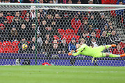 David Silva scores a goal past the diving Jack  Butland during the Premier League match between Stoke City and Manchester City at the Bet365 Stadium, Stoke-on-Trent, England on 12 March 2018. Picture by Graham Holt.