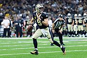 NEW ORLEANS, LA - SEPTEMBER 9:  Drew Brees #9 of the New Orleans Saints rolls out to pass during a game against the Tampa Bay Buccaneers at Mercedes-Benz Superdome on September 9, 2018 in New Orleans, Louisiana.  The Buccaneers defeated the Saints 48-40.  (Photo by Wesley Hitt/Getty Images) *** Local Caption *** Drew Brees
