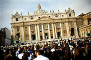 Pilgrims sitting in Saint Peter's Square in front of Saint Peter's Basilica in Rome, Italy, by the entrance to the Vatican City, the home of the Catholic Church.<br /> <br /> FOR MORE INFORMATION PLEASE WRITE TO ALEX@ALEXMASI.CO.UK<br /> <br /> **TEXT AND LENGHTY INTERVIEWS AVAILABLE**
