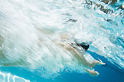 Swimmer captured from underwater with a extrusive time element for added emphasis.