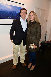 The HON.DANIEL BRENNAN and his wife REBECCA at a private view of Photographs by Julian Lennon held at The Little Black Gallery, 13A Park Walk, London SW10 on 17th September 2013.