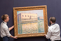 "© Licensed to London News Pictures. 20/02/2019. LONDON, UK. Technicians prepare to hang ""Le Palais Ducal"", 1908, by Claude Monet (Est. £20-30m). Preview of Sotheby's Impressionist & Modern and Surrealist Art sales.  The auction will take place at Sotheby's New Bond Street on 26 February 2019.  Photo credit: Stephen Chung/LNP"