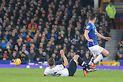 Tottenham Hotspur defender Eric Dier tackles Everton midfielder Gareth Barry  during the Barclays Premier League match between Everton and Tottenham Hotspur at Goodison Park, Liverpool, England on 3 January 2016. Photo by Simon Davies.