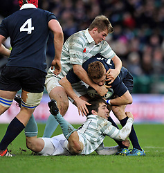 Ed Doe of Oxford University is double-tackled - Photo mandatory by-line: Patrick Khachfe/JMP - Mobile: 07966 386802 11/12/2014 - SPORT - RUGBY UNION - London - Twickenham Stadium - Oxford University v Cambridge University - The Varsity Match